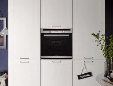 white kitchen larder with oven