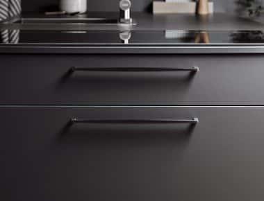 close up of black kitchen drawers