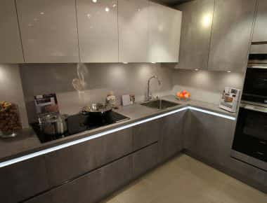 grey/silver kitchen with under cabinet lighting