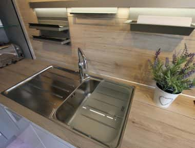 kitchen sink with glass cover