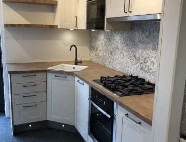 white kitchen with patterned splashback