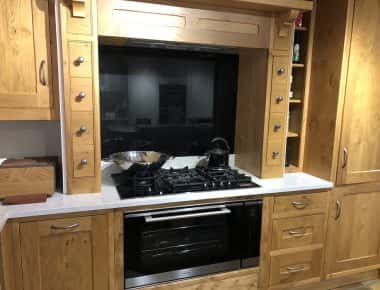 oak kitchen with black splashback